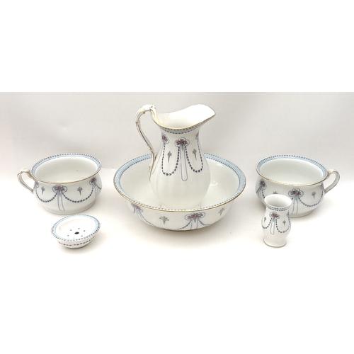 100 - A Victorian Losol Ware ceramic wash set, comprising jug, bowl, vase, soap dish, and two chamber pots...
