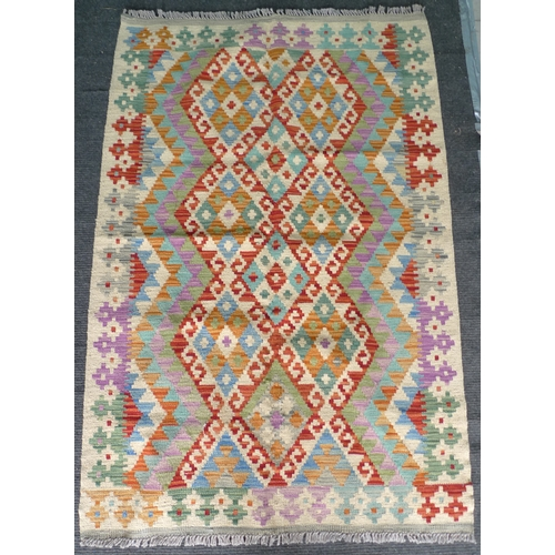 331 - A vegetable dyed wool Chobi Kelim rug, with diamond patterned field and geometric borders in green, ...