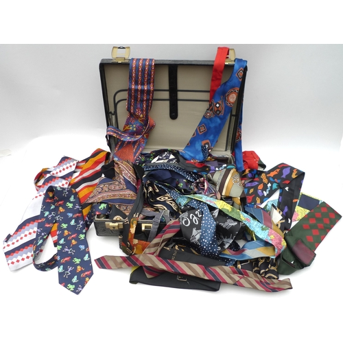 8 - A large collection of gentleman's silk ties and bow ties, including brands such as Lanvin, Paco Raba...