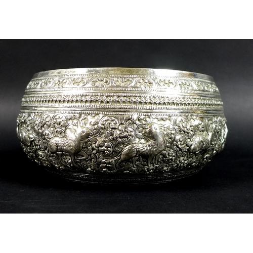 521 - A group of vintage Thai white metal items, comprising a set of four graduated bowls, the repoussé wo...