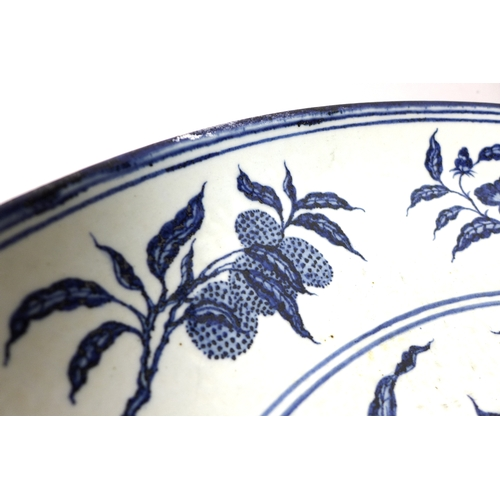 8 - A large Chinese Ming style blue and white dish, probably early 20th century, decorated in underglaze...