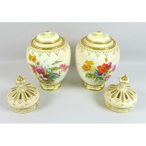 53 - A pair of modern Royal Worcester blush ivory potpourri vases and pierced covers, decorated in 'Victo...