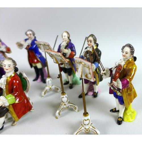 52 - A 20th century Rudolstadt Volkstedt Dresden porcelain part model orchestra, various figures forming ...