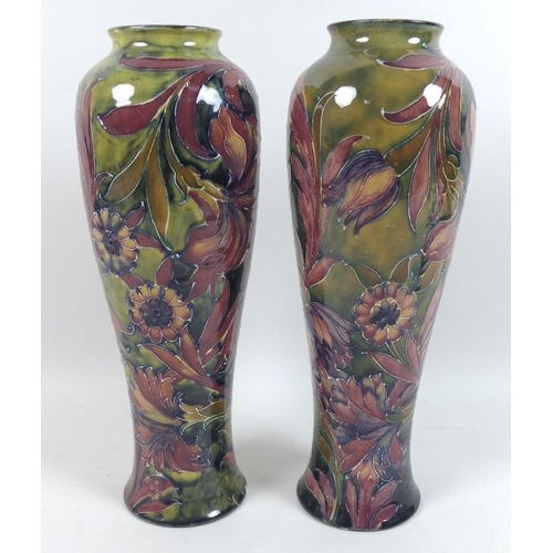 45 - A pair of William Moorcroft vases, circa 1915, of slender baluster form, decorated in the 'Spanish' ...