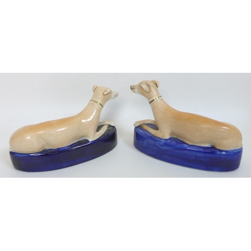 13 - A pair of 19th century Staffordshire greyhound pen stands or ink wells, 11cm high, together with a p...
