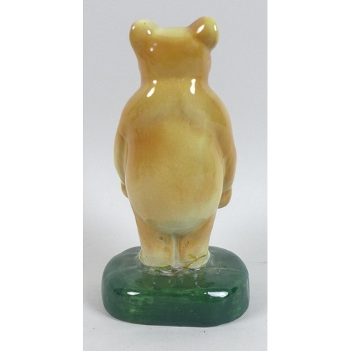 4 - A rare group of six Fulham Pottery Winnie-the-Pooh figurines, mid 20th century, modelled as Winnie T...
