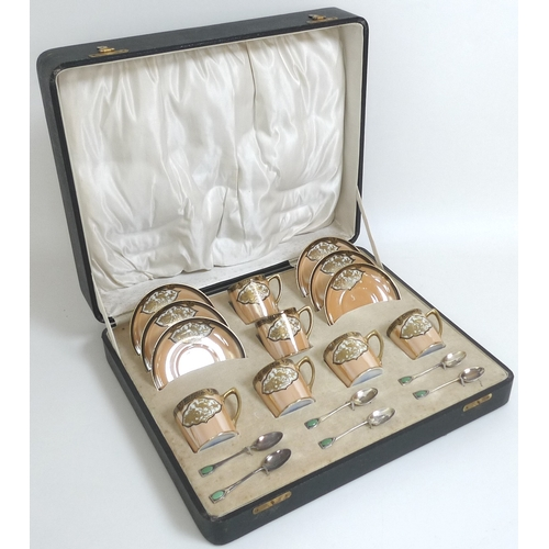 24 - An Art Deco cased Noritake and silver coffee set, comprising six coffee cans and six saucers, decora...