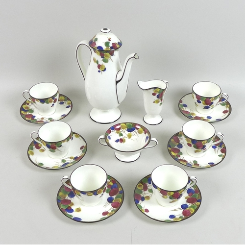 23 - An Art Deco Royal Doulton part coffee set, circa 1930, decorated in the 'Honesty' pattern with a ban...