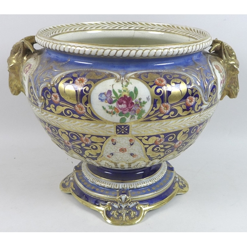 16 - A Continental porcelain jardiniere, 19th century, possibly Samson of Paris, with twin ram's head han...