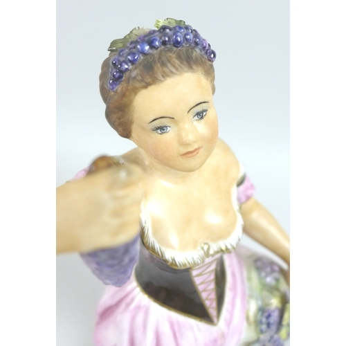 28 - A Royal Crown Derby porcelain figurine, modelled as 'Autumn', a lady standing holding bunches of gra...