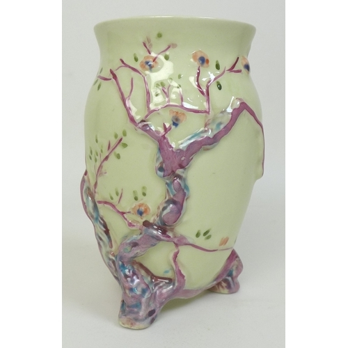 26 - A Clarice Cliff Newport Pottery vase, 'Indian Tree' pattern, of baluster form on three moulded branc...