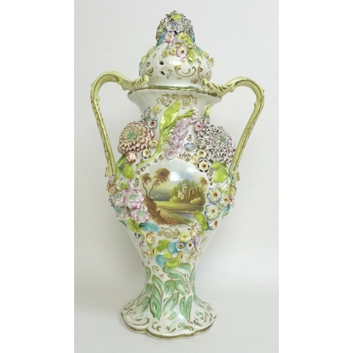6 - A 19th century porcelain twin handled vase and cover, possibly Coalbrookdale, moulded and applied fl...