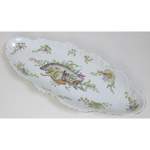 15 - A Continental porcelain fish platter, of twin handled oval form, decorated with fish, mussels, prawn...