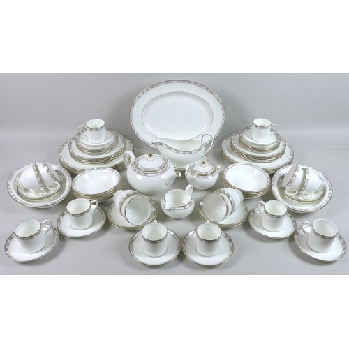 9 - A Wedgwood part dinner and tea service, decorated in the Colchester Pattern, eight place settings, c...