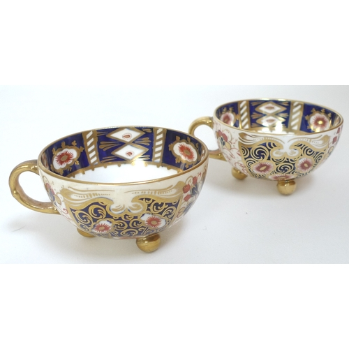 37 - A collection of 19th century cabinet teacups and saucers, including a Royal Crown Derby teacups and ...