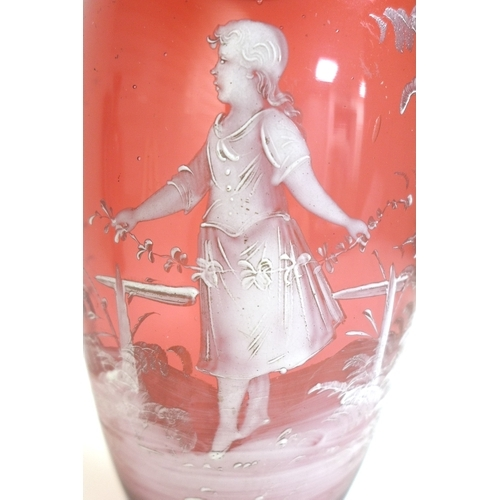 51 - A pair of ruby glass baluster vases by Mary Gregory, each pate sur pate decorated with a girl, band ...