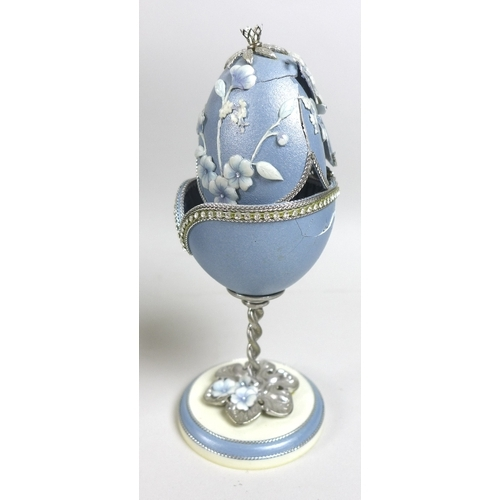 85 - A collection of unusual 20th century decorated eggs, ostrich, goose and emu, hand crafted some adapt...