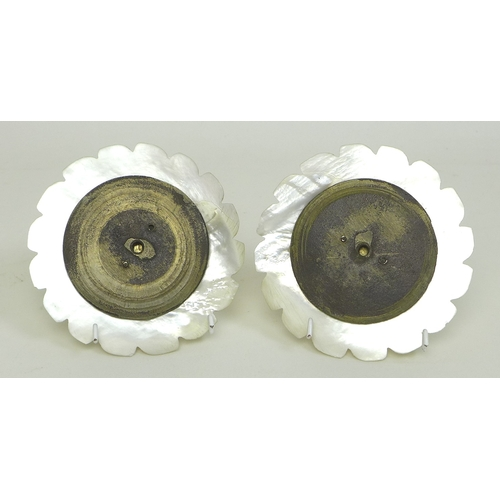 73 - A pair of Victorian carved mother of pearl decorative floral plaques, likely for curtain tie backs, ...