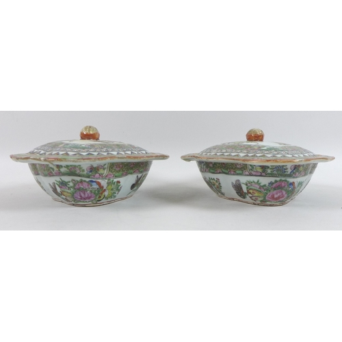 19 - A collection of modern Chinese Canton porcelain, including a pair of tureens with covers, a gravy bo...