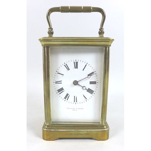 114 - A 19th century Hamilton & Inches Paris brass carriage clock, four glass case, oval window to top sho...