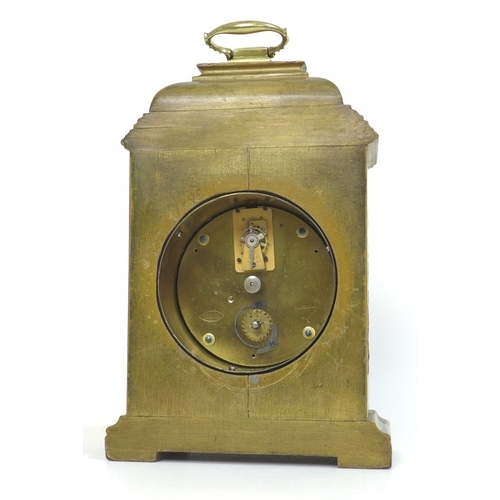 79 - A 20th century mantel clock, Chinoiserie decorated against a gold ground, the white dial with black ...