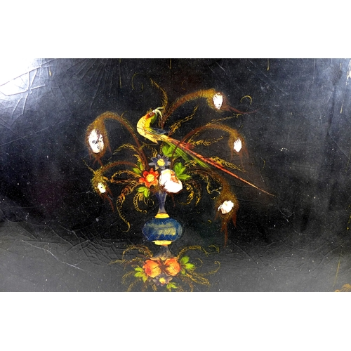 75 - A Victorian ebonised and tole painted papier mache tray, scalloped edge, painted with flowers and a ...
