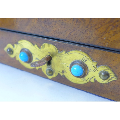 65 - An early 20th century wooden jewellery casket, brass mounted and set with eleven turquoise cabochons...
