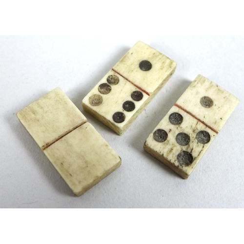 77 - A 19th century Napoleonic Prisoner-of-War bone carved set of miniature dominoes, comprising twenty s...