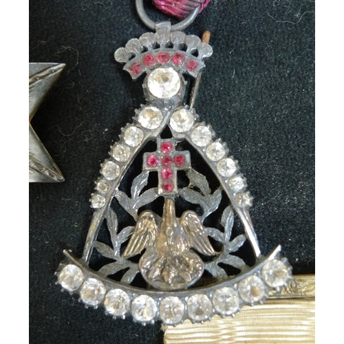 70 - A collection of twelve Masonic medals, all on a black fabric band, together with a Masonic apron, wh...