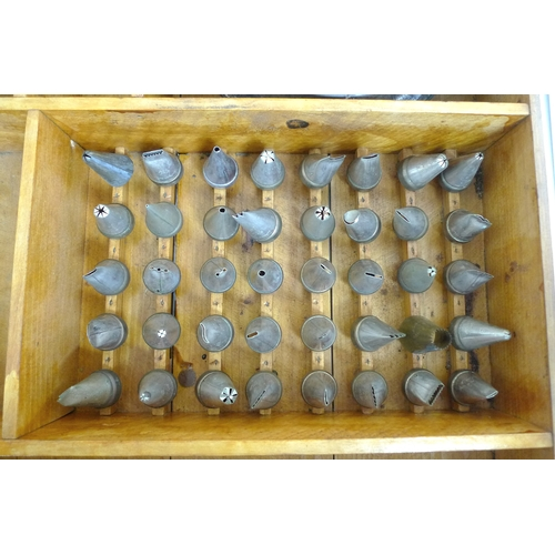 64 - A 1940s cake decorators set in fitted wooden case, with Tala branded bag, various nozzles, metal laz...
