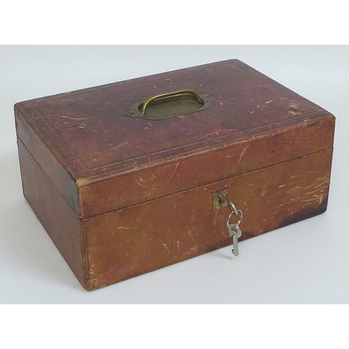 66 - A Victorian gilt tooled red leather lady's jewellery box, fitted interior containing glass jars with...