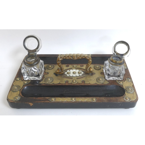 91 - A Victorian ebonised and brass mounted inkwell....