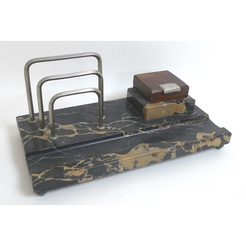 93 - An Art Deco marble desk stand with wooden lid....