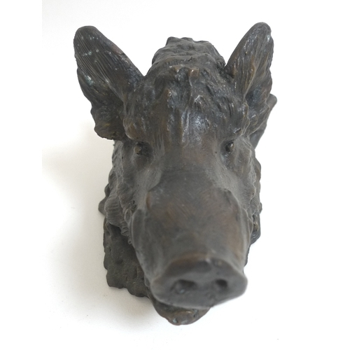 89 - A bronze inkwell in the form of a boar's head, hinged opening to reveal a ceramic bowl....