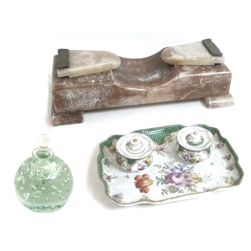 88 - A group of three desk stands, on a glass dump inkwell with finial cover, the second a Dresden porcel...
