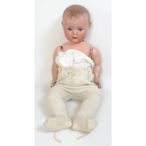 143 - A German bisque headed doll together with a plush teddy bear, doll measures 69cm long and bear 60cm ...