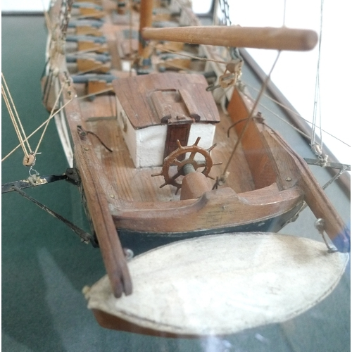 148 - A scratch built model brigantine, circa 1970, in five glass display case, model approximately 64 by ...
