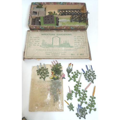 129 - A group of vintage cast metal toy figures including two W Britain Miniature Gardening sets, No 9 MG ...