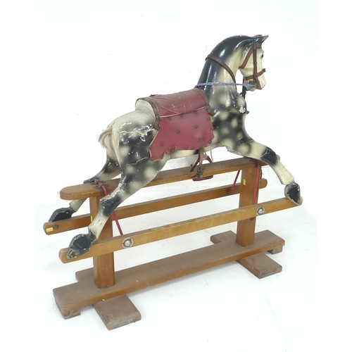 147 - A small early to mid 20th century rocking horse, carved wooden body painted dapple grey with red sad...
