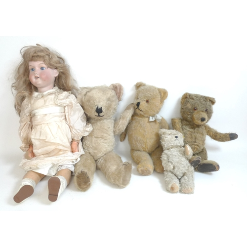 144 - An Armand Marseille bisque headed doll, early 20th century, together with four vintage teddies of va...