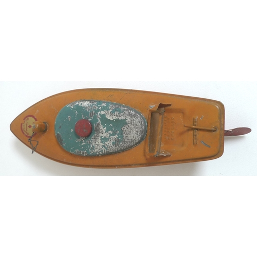 120 - A group of vintage tin plate toys, including a Silver Streak model speed boat, boxed, a Sutcliffe mo...