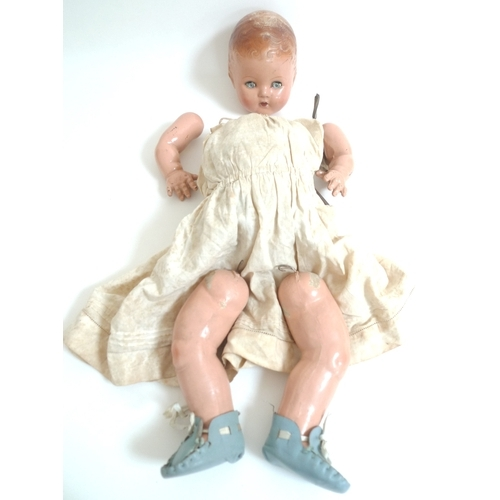 142 - A group of vintage dolls, including an Armand Marseille doll, marked 975, 40cm long, and a BND, Lond...