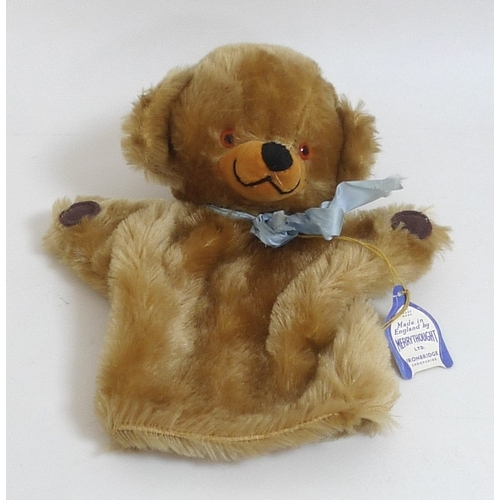 145 - A Merrythought bear hand puppet, circa 1960, with label, together with a panda soft toy, puppet meas...