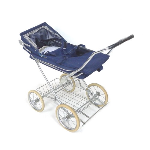 146 - A Charlesworth dolls pram, with adjustable hood and metal under carriage shopping tray, 83 by 45 by ...
