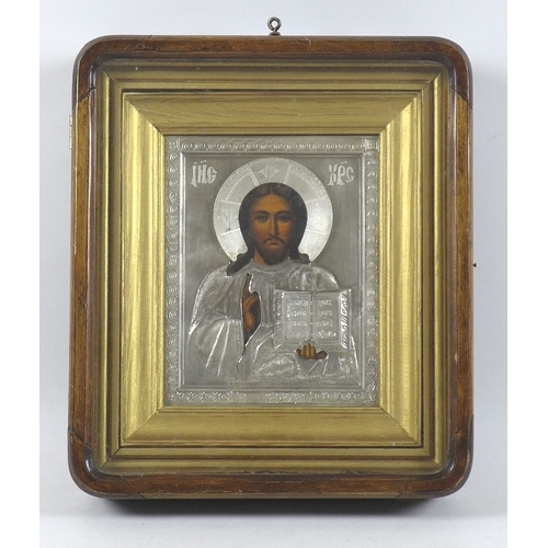 205 - A late 19th century Russian icon, tempera on panel of Christ Pantocrator, the figure of Christ paint...