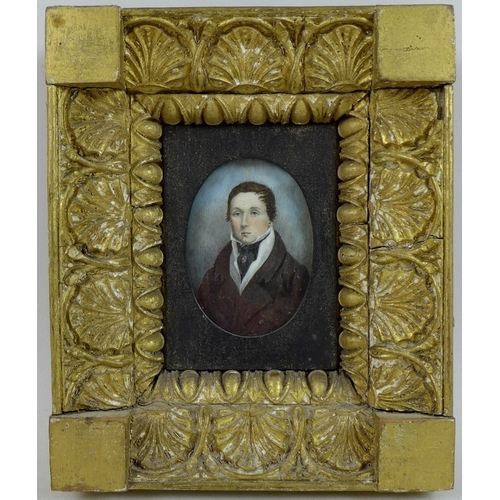 174 - An early 19th century miniature portrait on ivory, depicting a man in brown coat, white shirt and bl...
