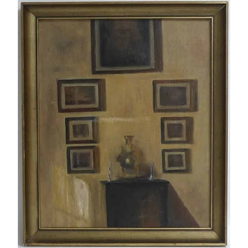 203 - Dutch School (early 20th century): still life of a wall hung with seven paintings and a cabinet belo...