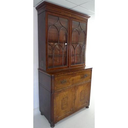300 - A George III inlaid mahogany secretaire bookcase, the flared cornice above vase and leaf scroll deco...