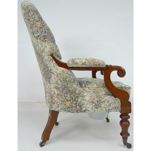 237 - A Victorian Spademan of Stamford mahogany commode in the form of a nursing chair, upholstered seat c...