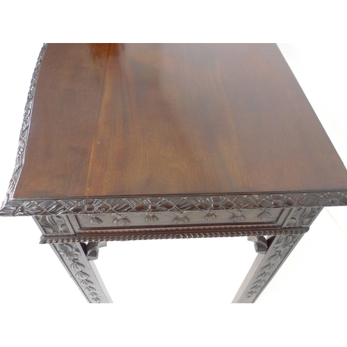 239 - An Edwardian mahogany server, of rectangular form with gently bowed front edge, decoratively carved ...